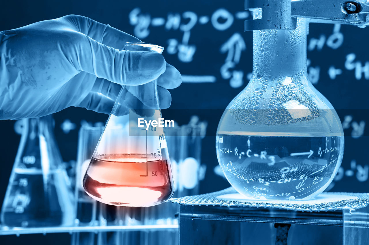 transparent, glass - material, laboratory, science, chemistry, scientific experiment, research, indoors, healthcare and medicine, education, laboratory glassware, close-up, focus on foreground, chemical, blue, no people, laboratory equipment, technology, container, biotechnology, glass, biology, genetic research, chemistry class