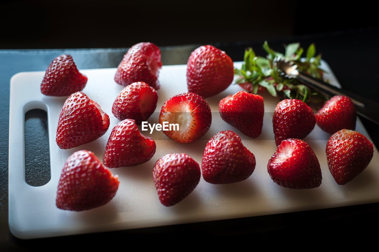 Close-Up Of Strawberries On Cutting Board At Table