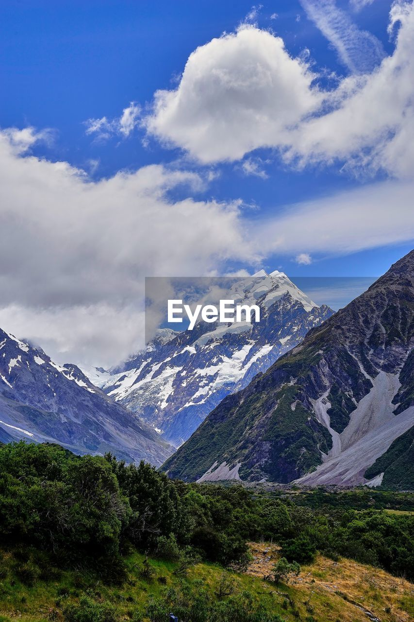 mountain, nature, beauty in nature, scenics, sky, snow, tranquil scene, cloud - sky, mountain range, landscape, tranquility, snowcapped mountain, day, wilderness, no people, outdoors, scenery