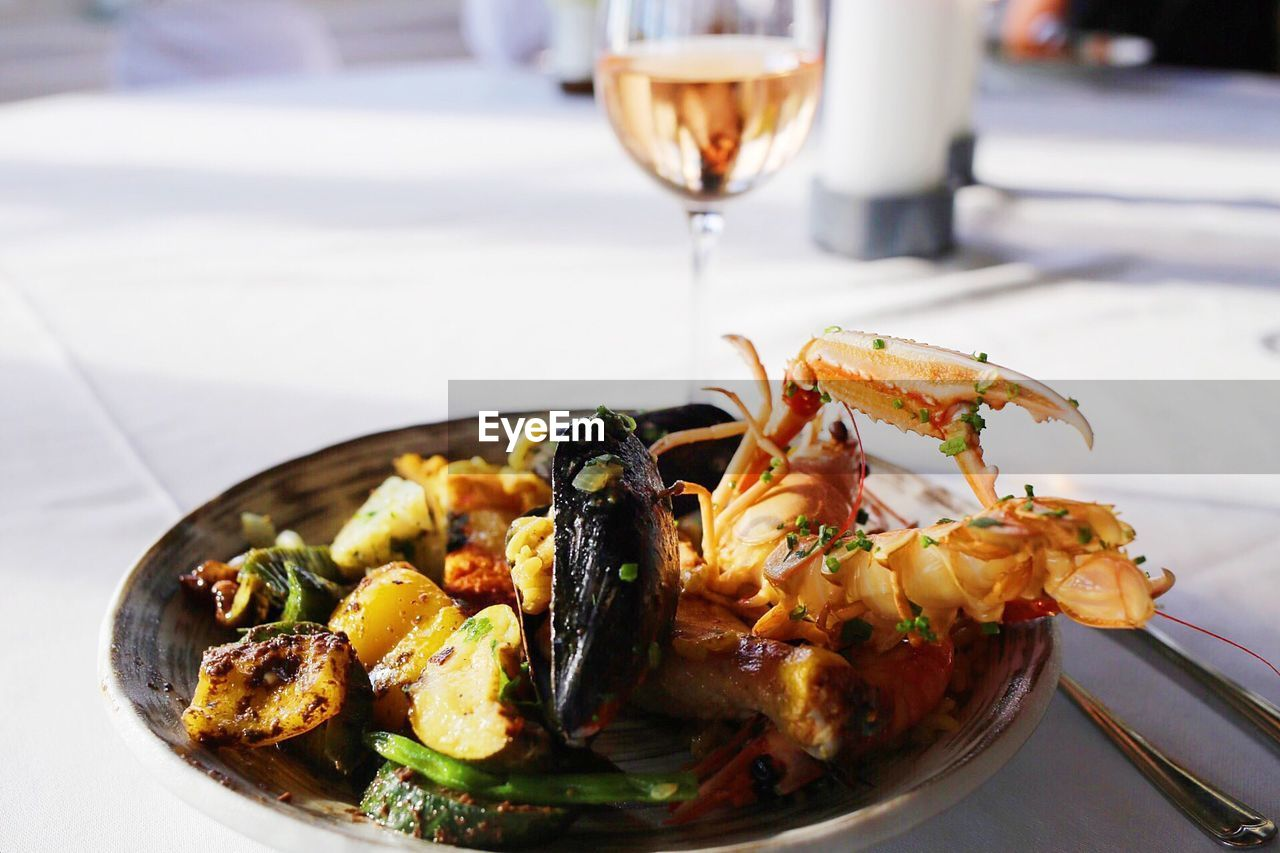 Close-Up Of Paella Served In Plate On Table In Restaurant