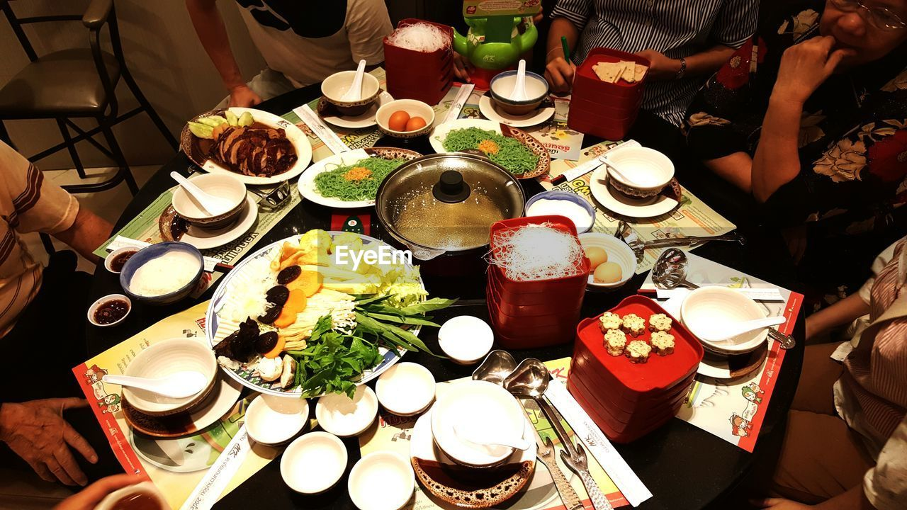 food and drink, food, table, plate, high angle view, freshness, real people, healthy eating, indoors, ready-to-eat, meal, variation, choice, healthy lifestyle, human hand, men, human body part, day, people