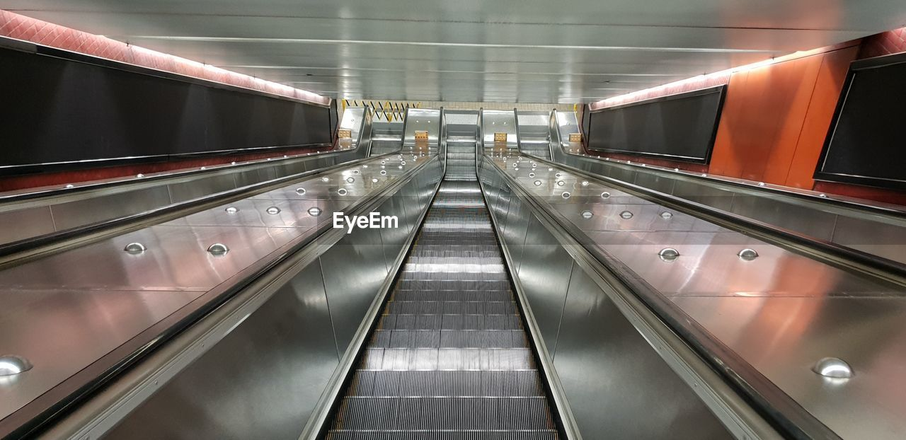 transportation, illuminated, architecture, railing, the way forward, indoors, direction, convenience, escalator, modern, technology, moving walkway, no people, diminishing perspective, built structure, motion, steps and staircases, staircase, connection, lighting equipment, ceiling