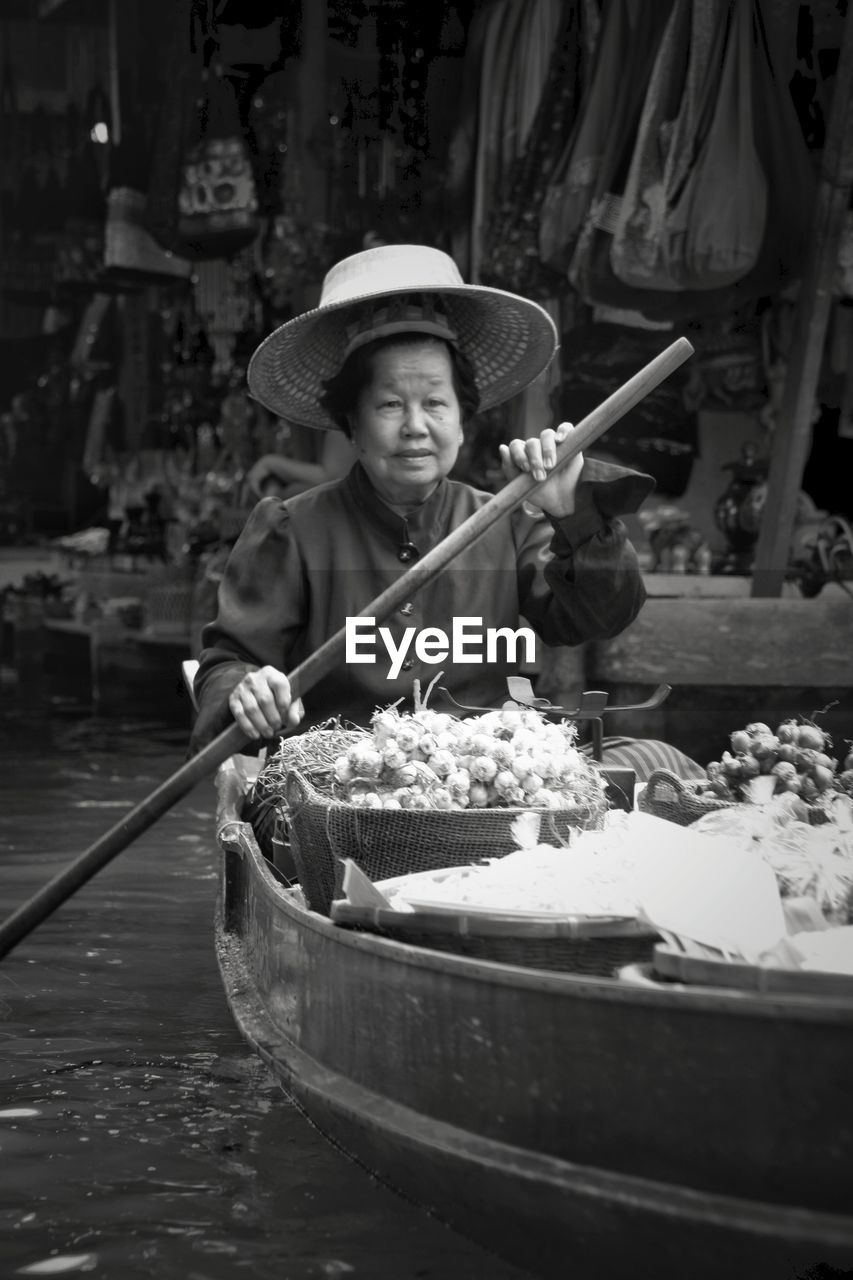 Woman in boat at floating market