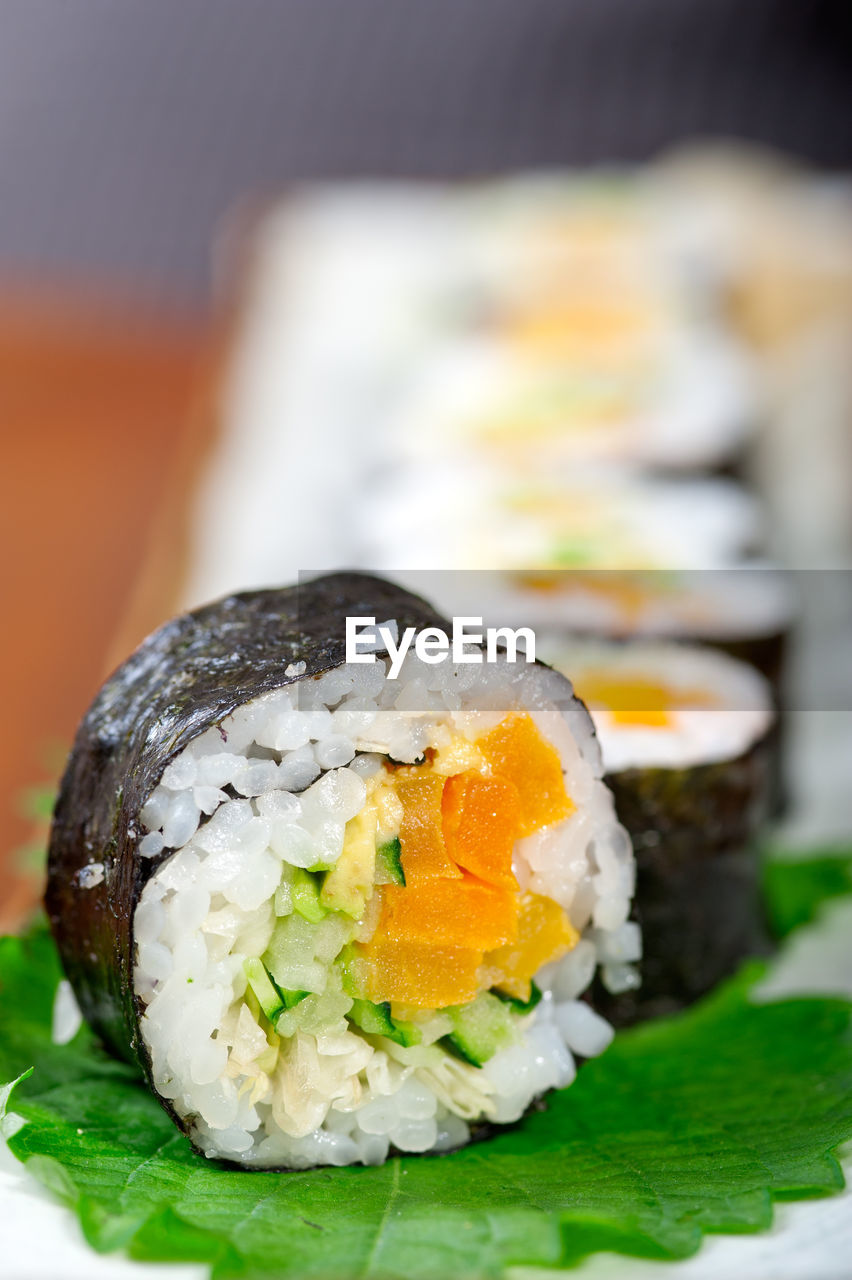 sushi, food and drink, japanese food, freshness, rice - food staple, seafood, food, ready-to-eat, healthy eating, rolled up, plate, fish, focus on foreground, close-up, no people, serving size, indoors, sashimi, day