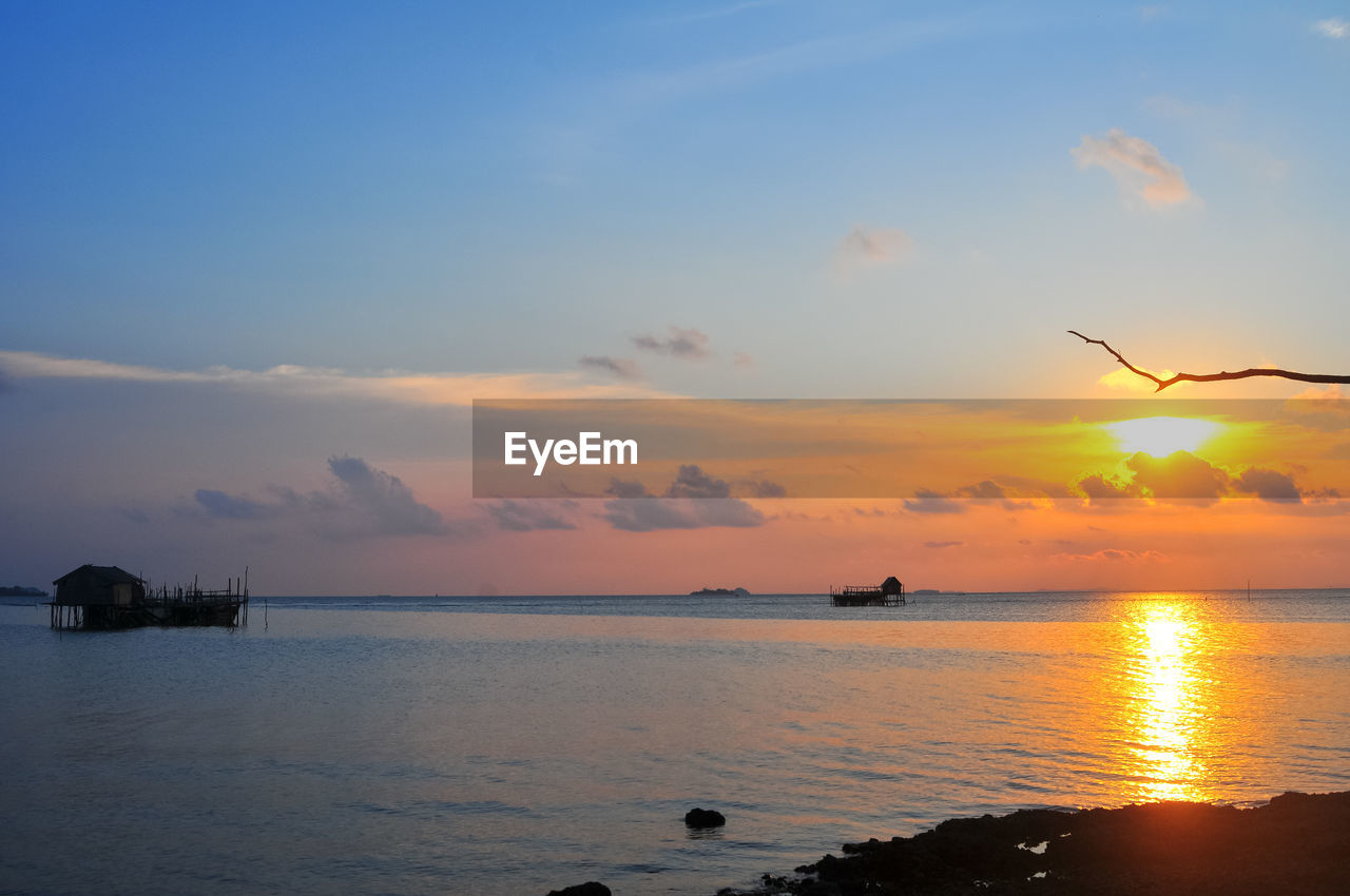 sky, sunset, water, scenics - nature, beauty in nature, sea, cloud - sky, orange color, tranquil scene, tranquility, horizon over water, idyllic, nature, reflection, horizon, sun, beach, no people, land, outdoors