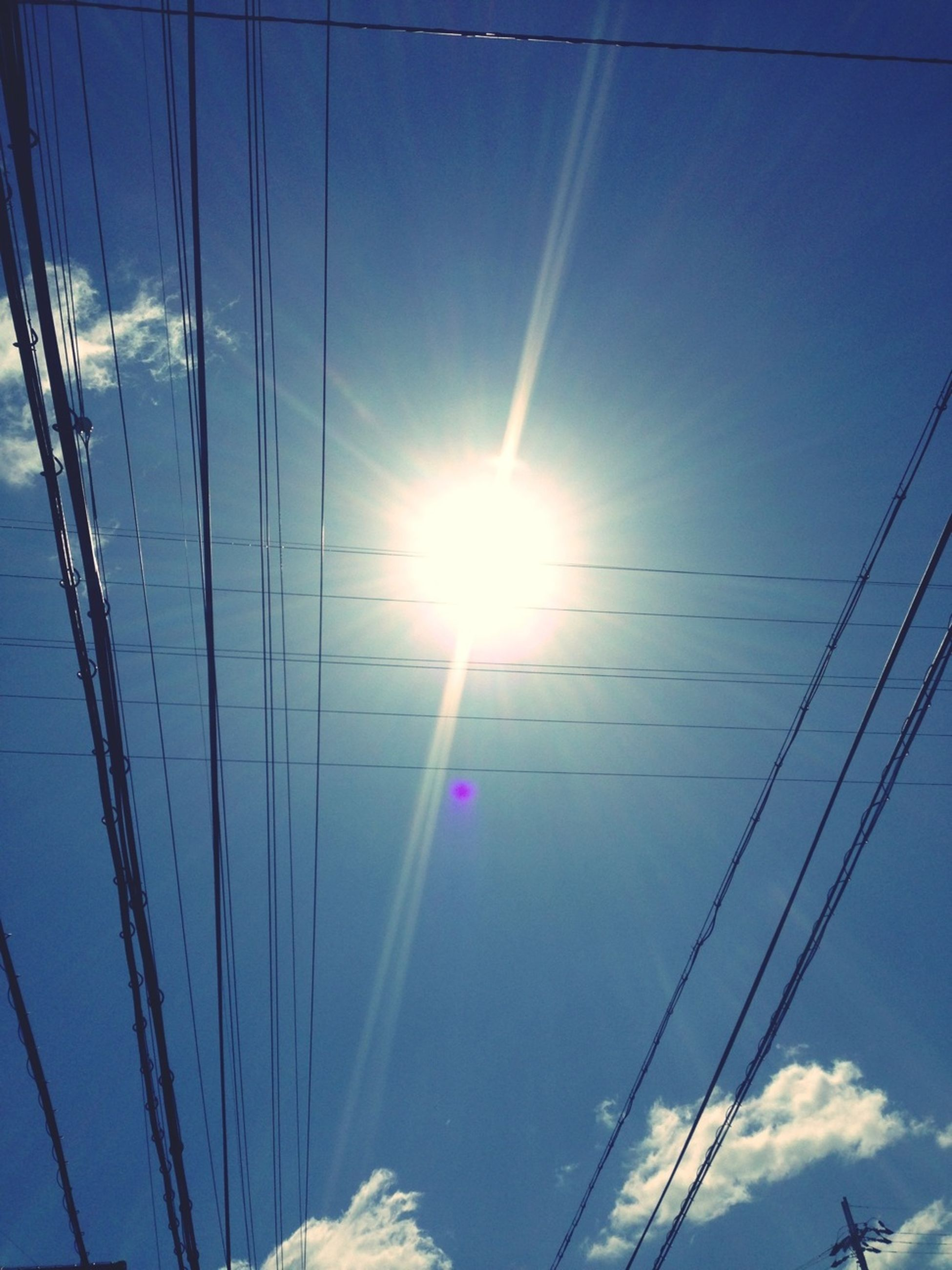 power line, low angle view, sun, blue, cable, connection, electricity, power supply, electricity pylon, sunbeam, sunlight, sky, lens flare, fuel and power generation, power cable, vapor trail, technology, day, bright, nature