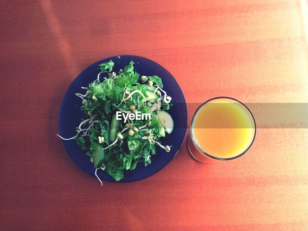 Salad And Glass Of Orange Juice