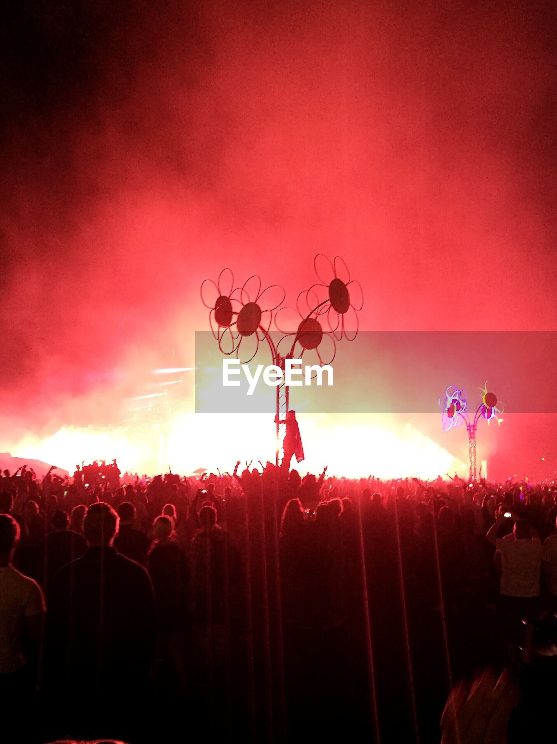 large group of people, fun, night, sunset, arts culture and entertainment, crowd, illuminated, enjoyment, togetherness, real people, event, outdoors, celebration, leisure activity, men, multi colored, sky, women, excitement, nature, people
