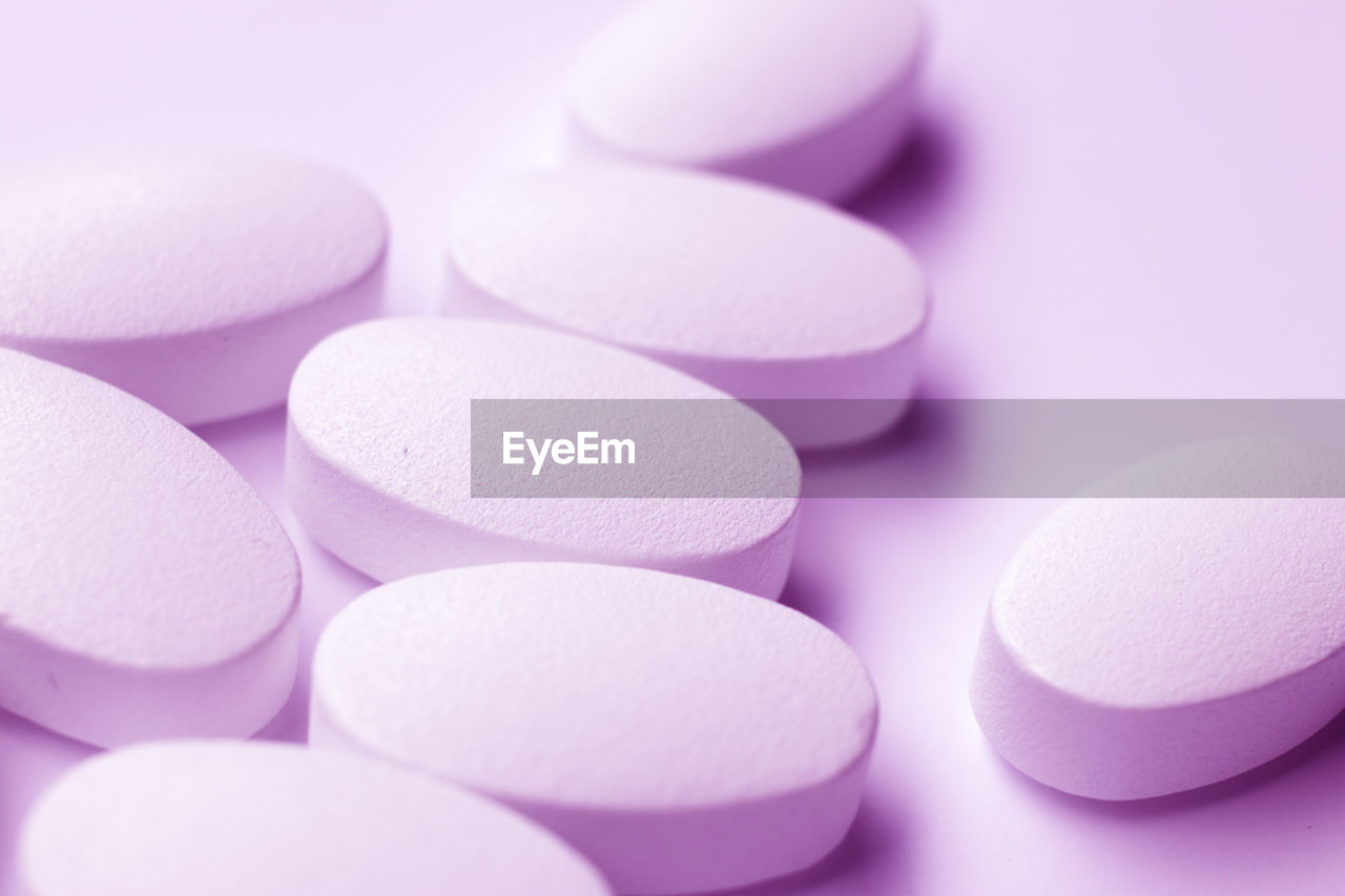 Close-up of medicines over purple background