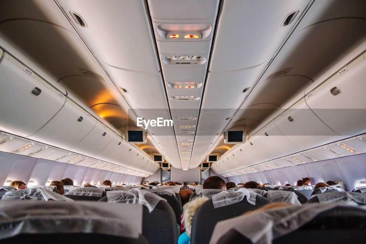 People traveling in airplane
