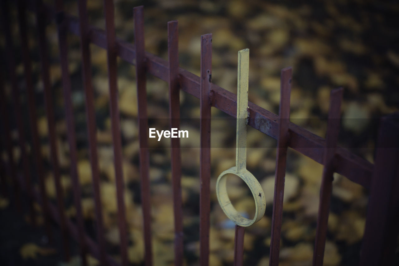 metal, focus on foreground, no people, hanging, close-up, day, outdoors