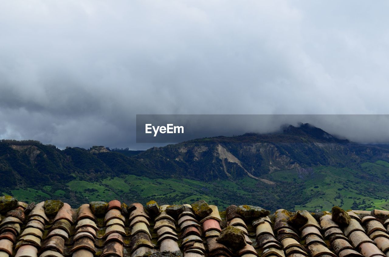 cloud - sky, mountain, sky, mountain range, nature, no people, stack, scenics - nature, environment, beauty in nature, large group of objects, day, landscape, tranquil scene, outdoors, arrangement, tranquility, side by side, in a row, roof tile