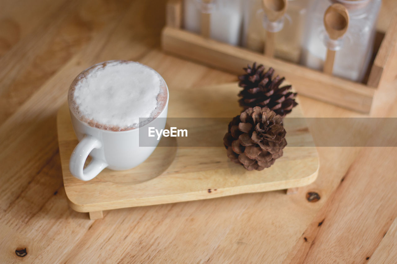 food and drink, wood - material, food, indoors, table, coffee - drink, still life, coffee, freshness, cutting board, mug, roasted coffee bean, no people, high angle view, coffee cup, refreshment, cup, drink, spice, close-up, latte, tray, caffeine, snack