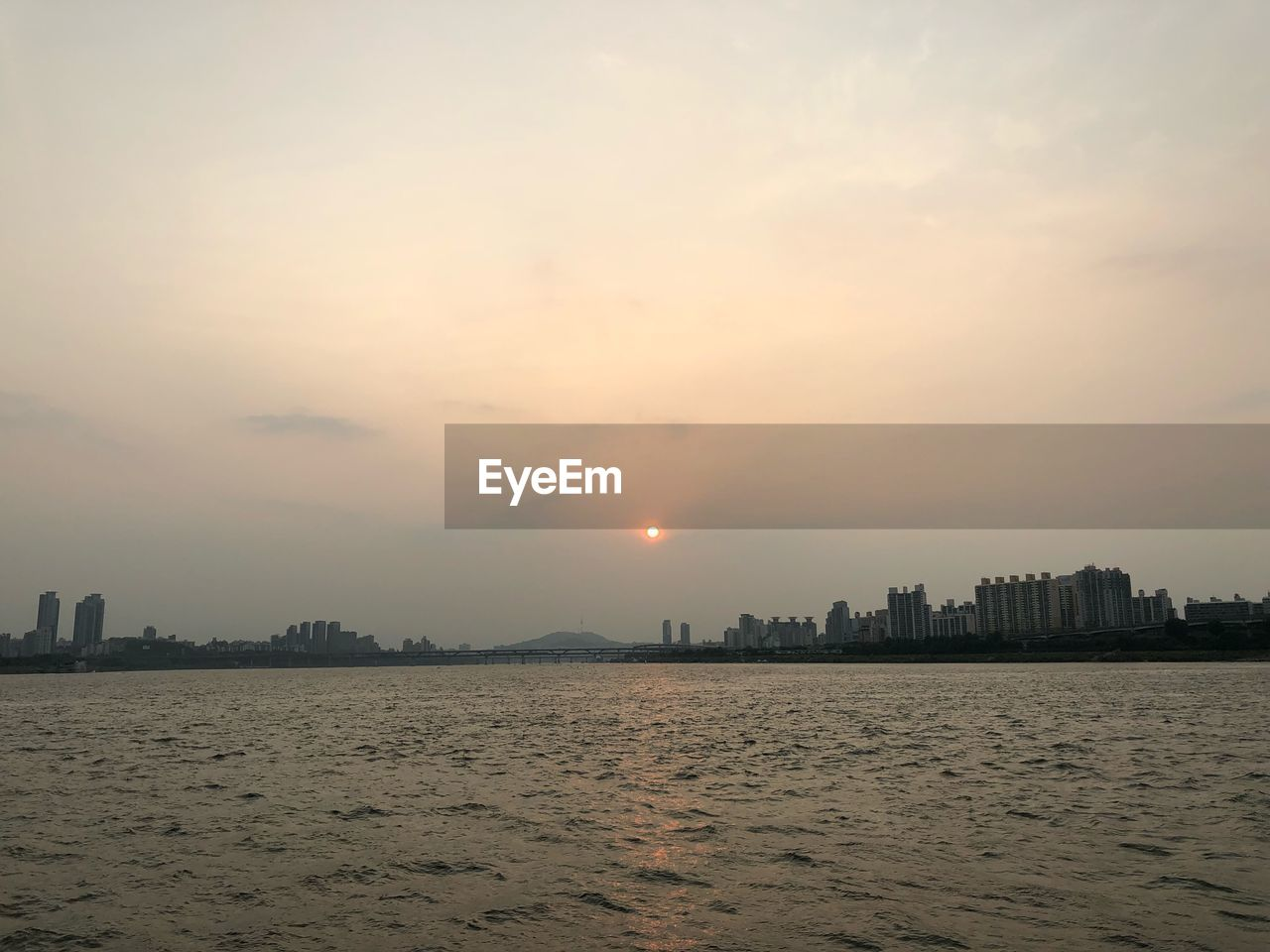 sky, architecture, building exterior, built structure, waterfront, sunset, water, city, cityscape, building, sun, landscape, nature, no people, urban skyline, sea, skyscraper, office building exterior, beauty in nature, outdoors