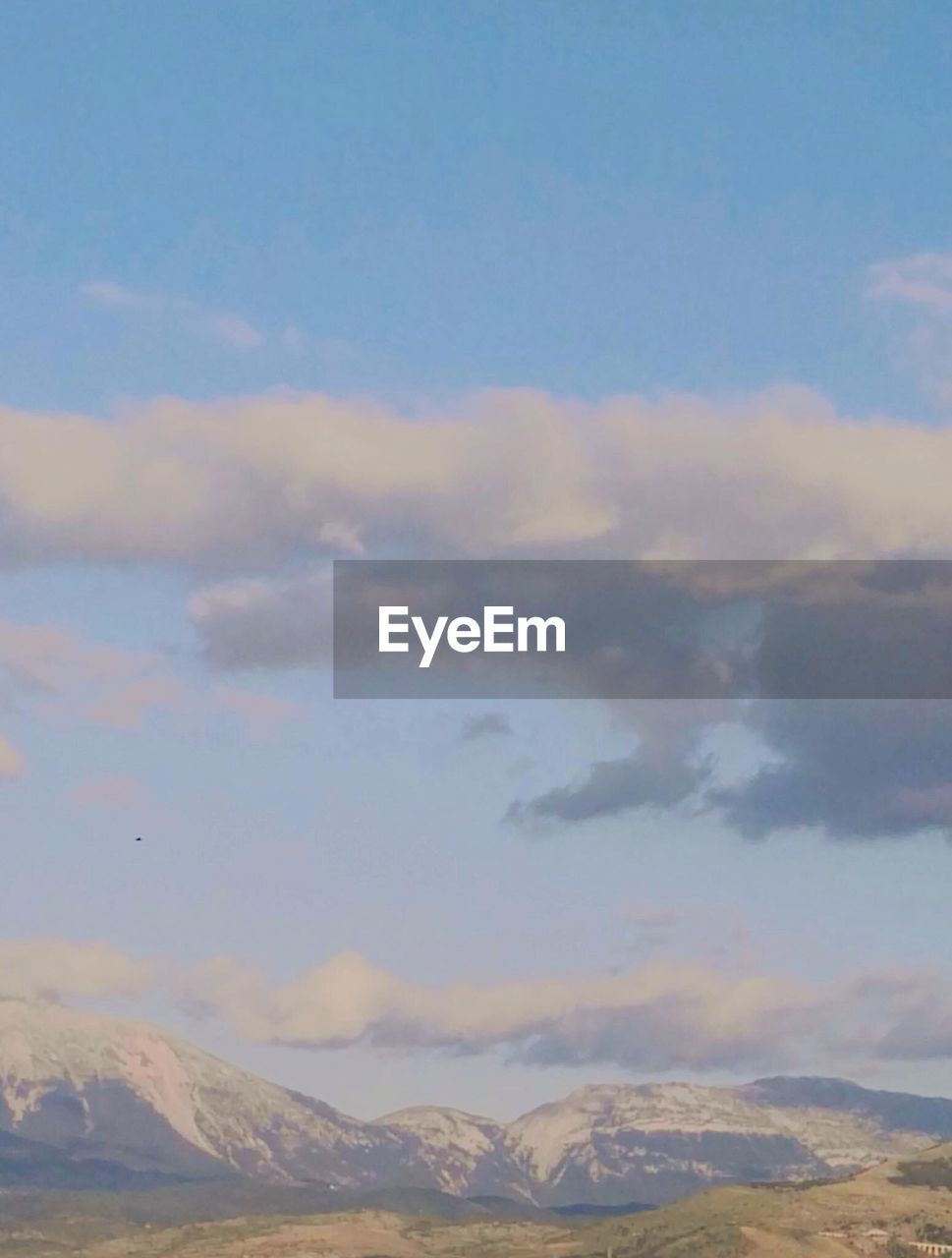 sky, cloud - sky, scenics - nature, beauty in nature, tranquil scene, mountain, tranquility, no people, nature, mountain range, environment, sunset, non-urban scene, idyllic, day, outdoors, landscape, cloudscape, cold temperature, snowcapped mountain, mountain peak, meteorology