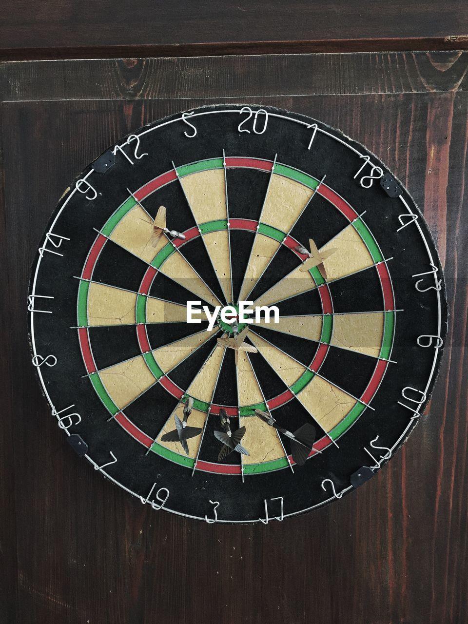 Dart in bullseye of dart board