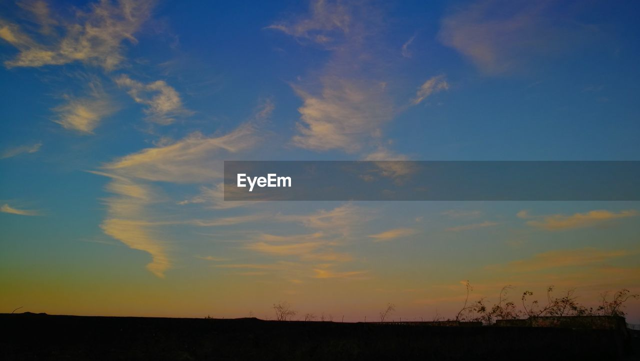 sky, cloud - sky, beauty in nature, sunset, tranquil scene, scenics - nature, tranquility, environment, landscape, nature, orange color, no people, field, horizon over land, land, non-urban scene, silhouette, outdoors, horizon, idyllic