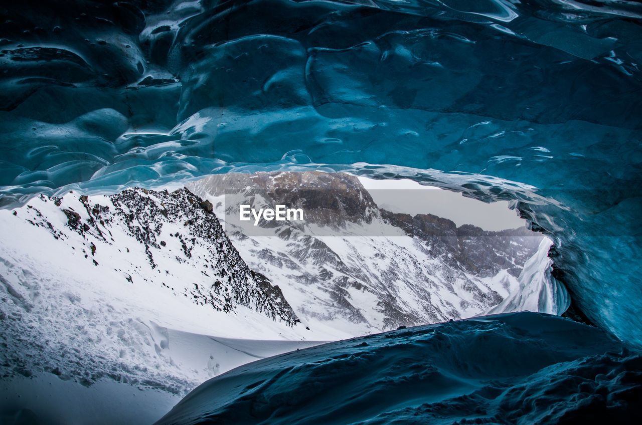 Close-Up Of Frozen Sea Against Mountain