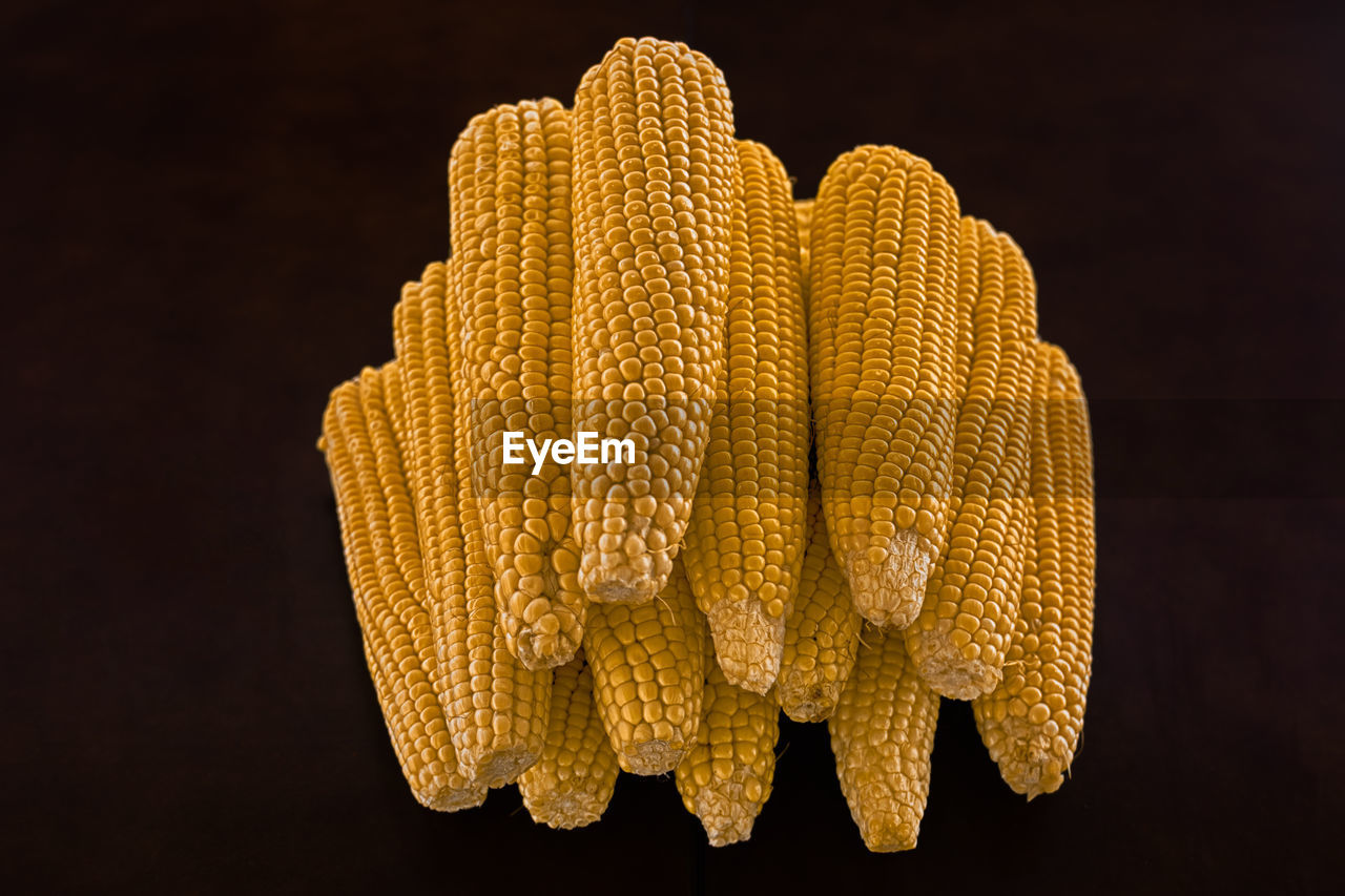 yellow, corn, studio shot, close-up, indoors, food, still life, black background, vegetable, food and drink, corn on the cob, wellbeing, no people, healthy eating, sweetcorn, freshness, orange color, pattern, focus on foreground, raw food