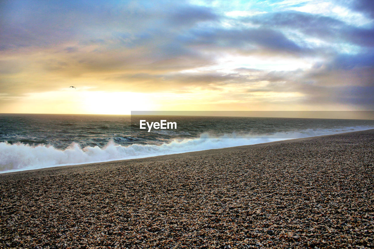 beach, water, sky, land, sea, cloud - sky, beauty in nature, scenics - nature, horizon over water, horizon, sunset, tranquility, wave, tranquil scene, nature, no people, motion, aquatic sport, idyllic, outdoors, pebble