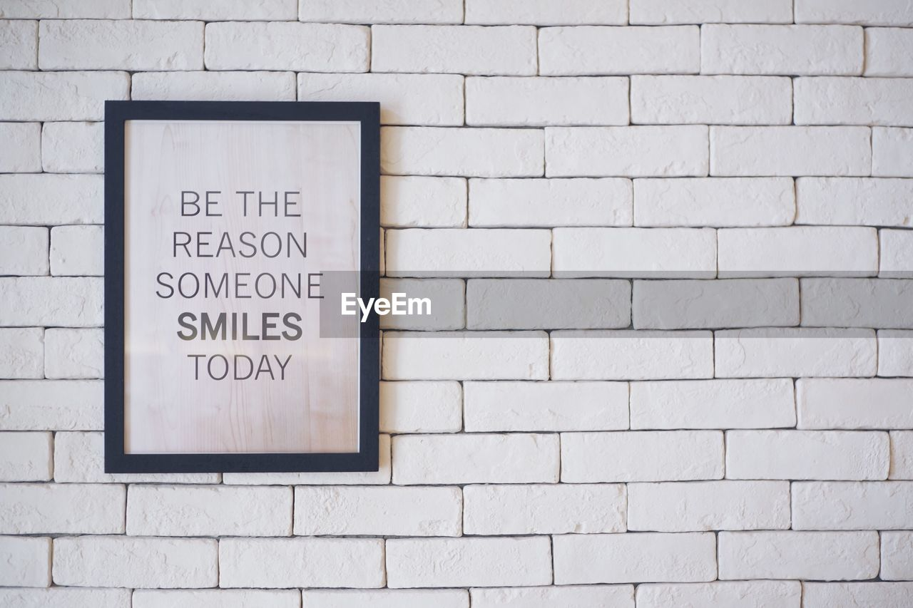 text, western script, wall - building feature, brick wall, communication, guidance, no people, day, built structure, architecture, instructions, placard, reminder, close-up, outdoors