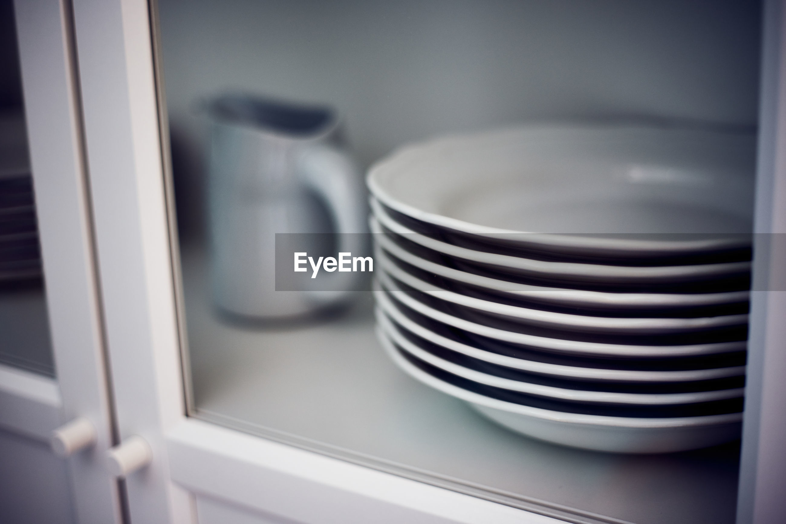 White dishes in a row in a furniture