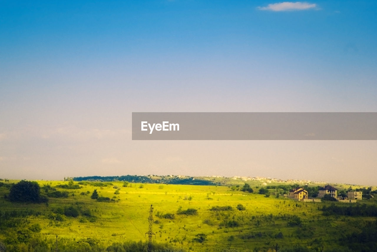 environment, landscape, sky, scenics - nature, tranquil scene, field, beauty in nature, plant, tranquility, nature, land, no people, horizon over land, agriculture, copy space, rural scene, grass, outdoors, non-urban scene, day