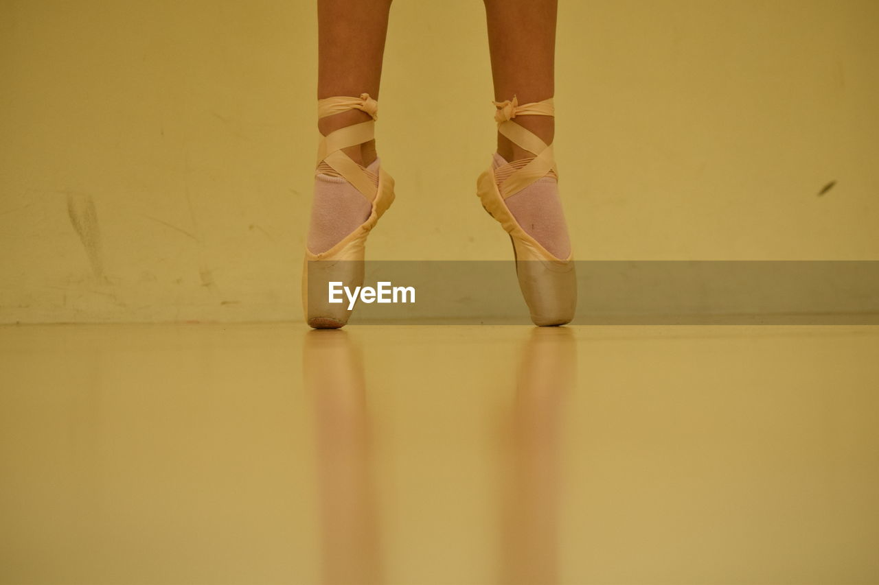Low Section Of Ballet Dancer Tiptoeing On Floor
