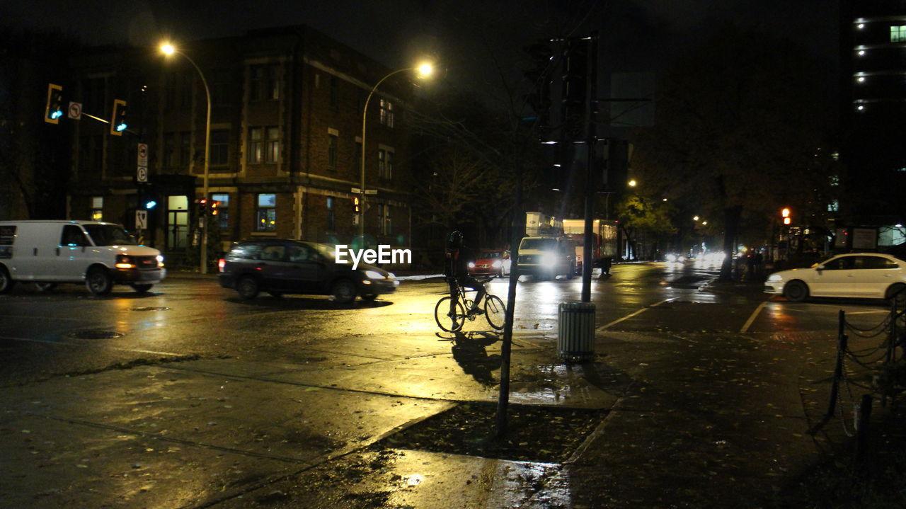CARS ON CITY STREET DURING RAINY SEASON
