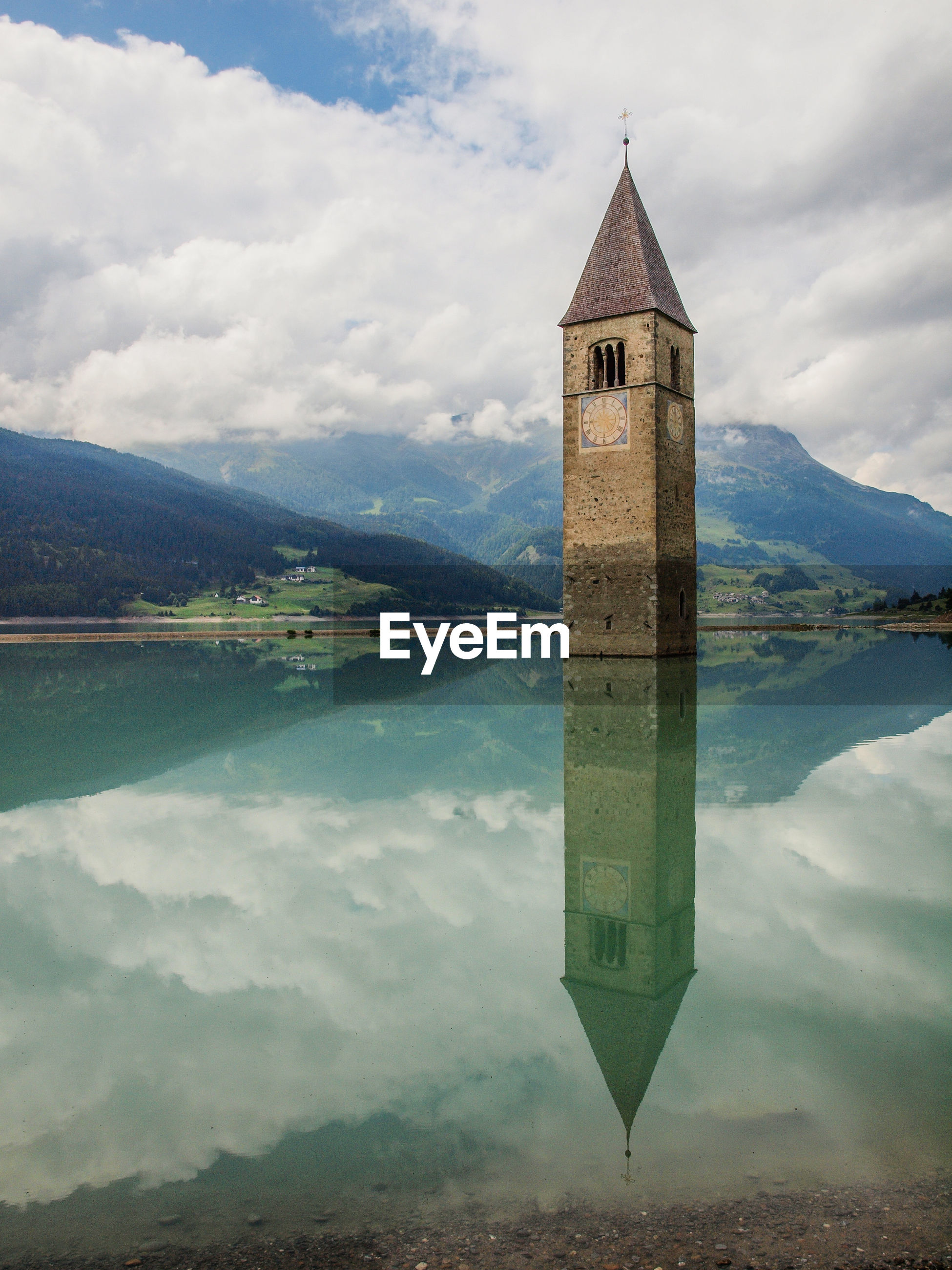 REFLECTION OF TOWER ON LAKE