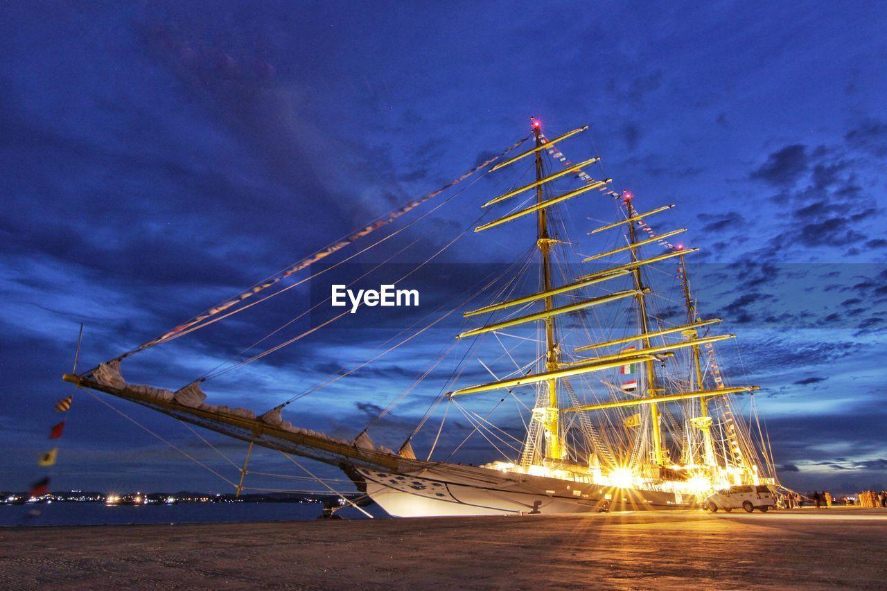 nautical vessel, transportation, sky, cloud - sky, mode of transport, mast, outdoors, no people, dusk, sailboat, night, nature, sea, water, moored, blue, tall ship, sailing ship, sailing
