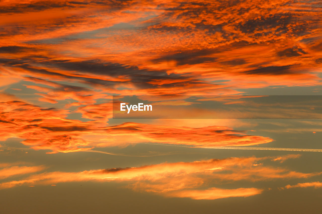 sunset, beauty in nature, nature, orange color, sky, scenics, tranquility, cloud - sky, tranquil scene, dramatic sky, no people, outdoors, backgrounds, low angle view, sky only, day
