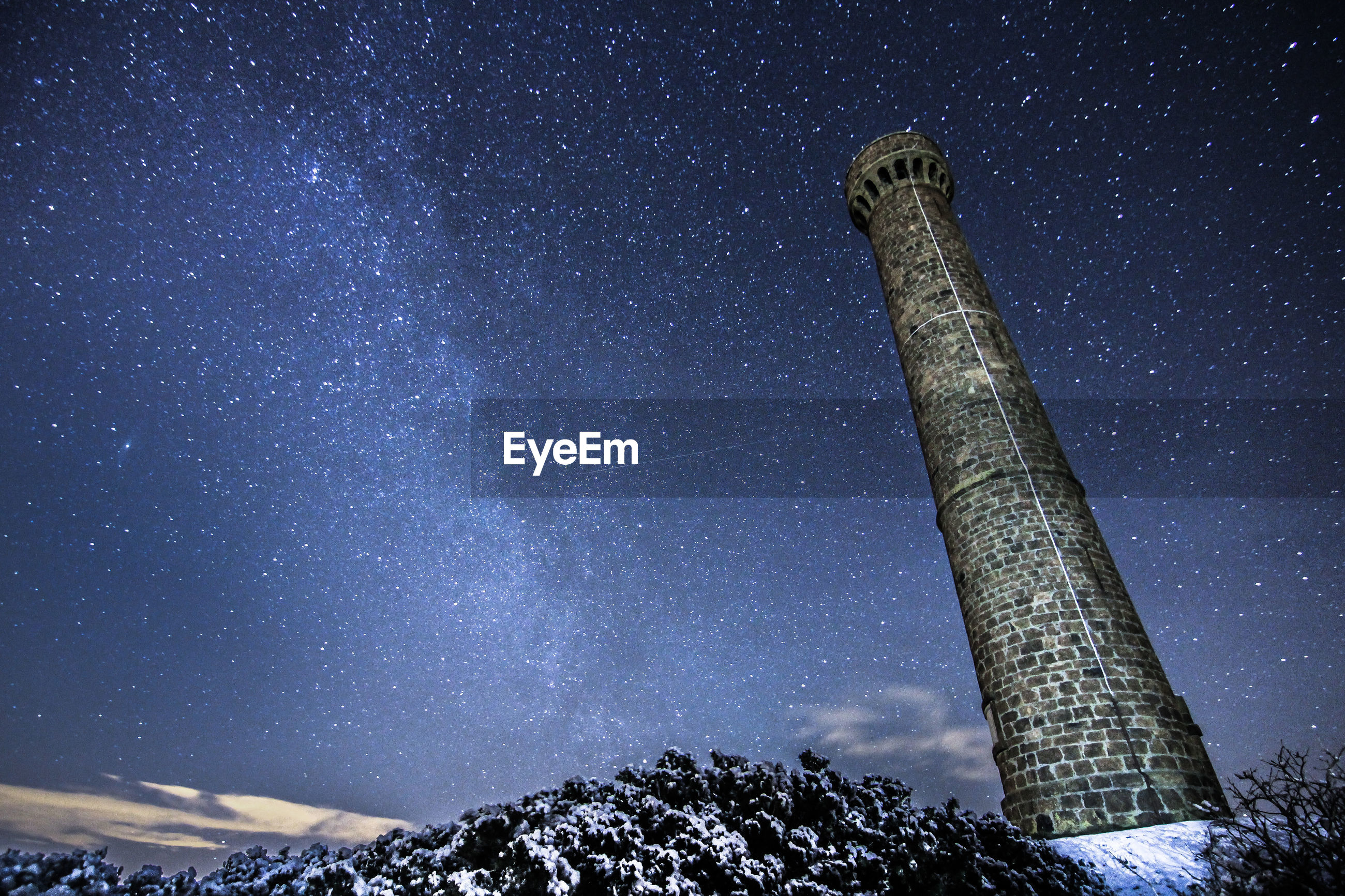 Low angle view of hopetoun monument against star field at night during winter