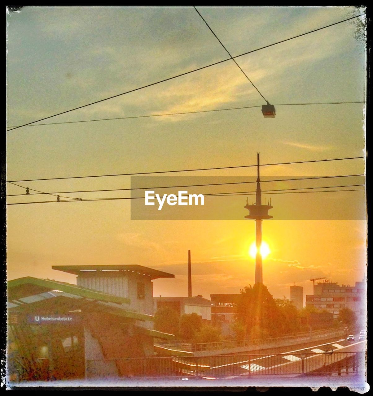 sunset, cable, sky, built structure, building exterior, architecture, transportation, connection, power line, no people, outdoors, sun, silhouette, electricity pylon, nature, city, water, day
