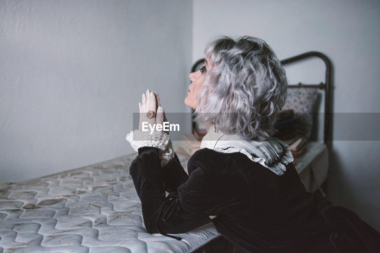Woman praying at home