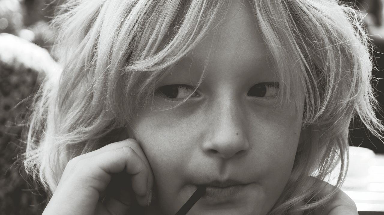 Close-Up Of Thoughtful Girl Looking Away