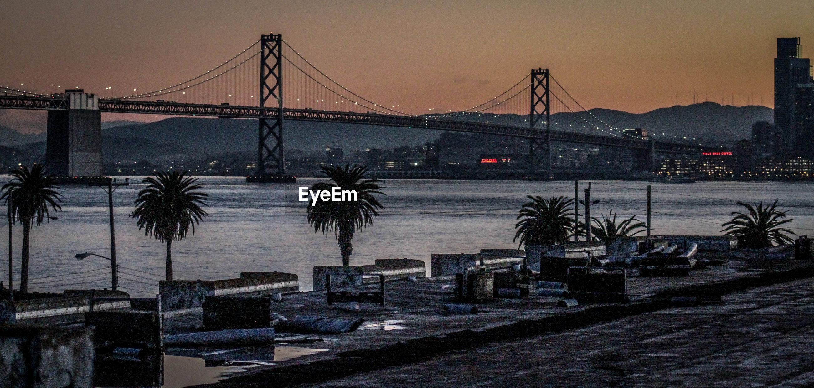 VIEW OF SUSPENSION BRIDGE AT WATERFRONT