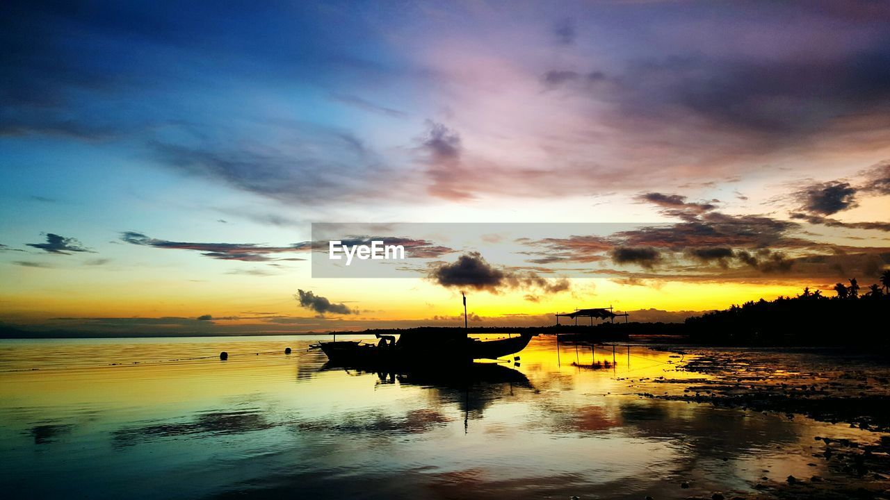 sunset, reflection, sky, tranquil scene, water, tranquility, scenics, beauty in nature, nature, cloud - sky, lake, idyllic, silhouette, no people, outdoors, waterfront, tree, day