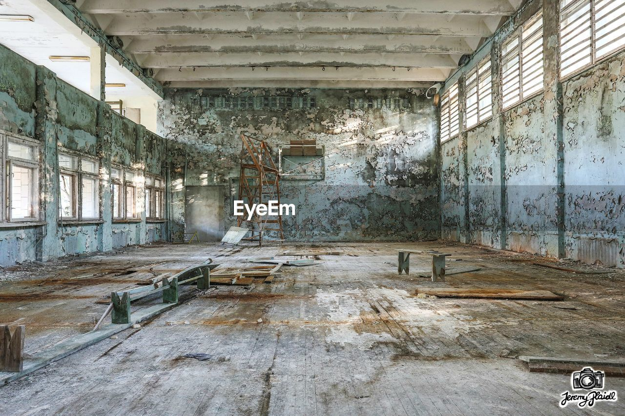 indoors, abandoned, ceiling, architecture, built structure, window, no people, old-fashioned, day, factory