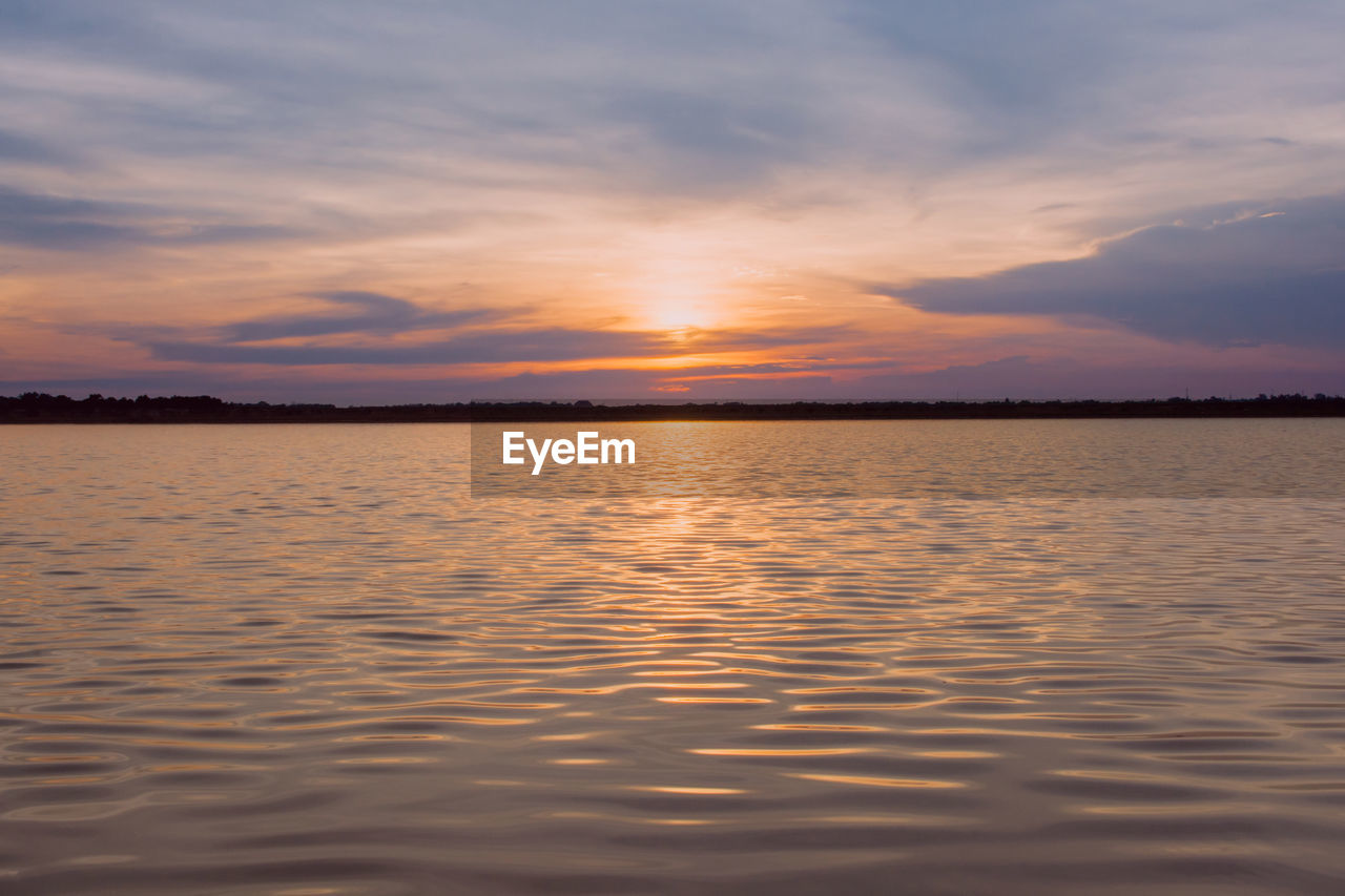 sky, sunset, water, tranquility, cloud - sky, beauty in nature, scenics - nature, tranquil scene, waterfront, nature, orange color, idyllic, no people, sea, remote, non-urban scene, reflection, outdoors