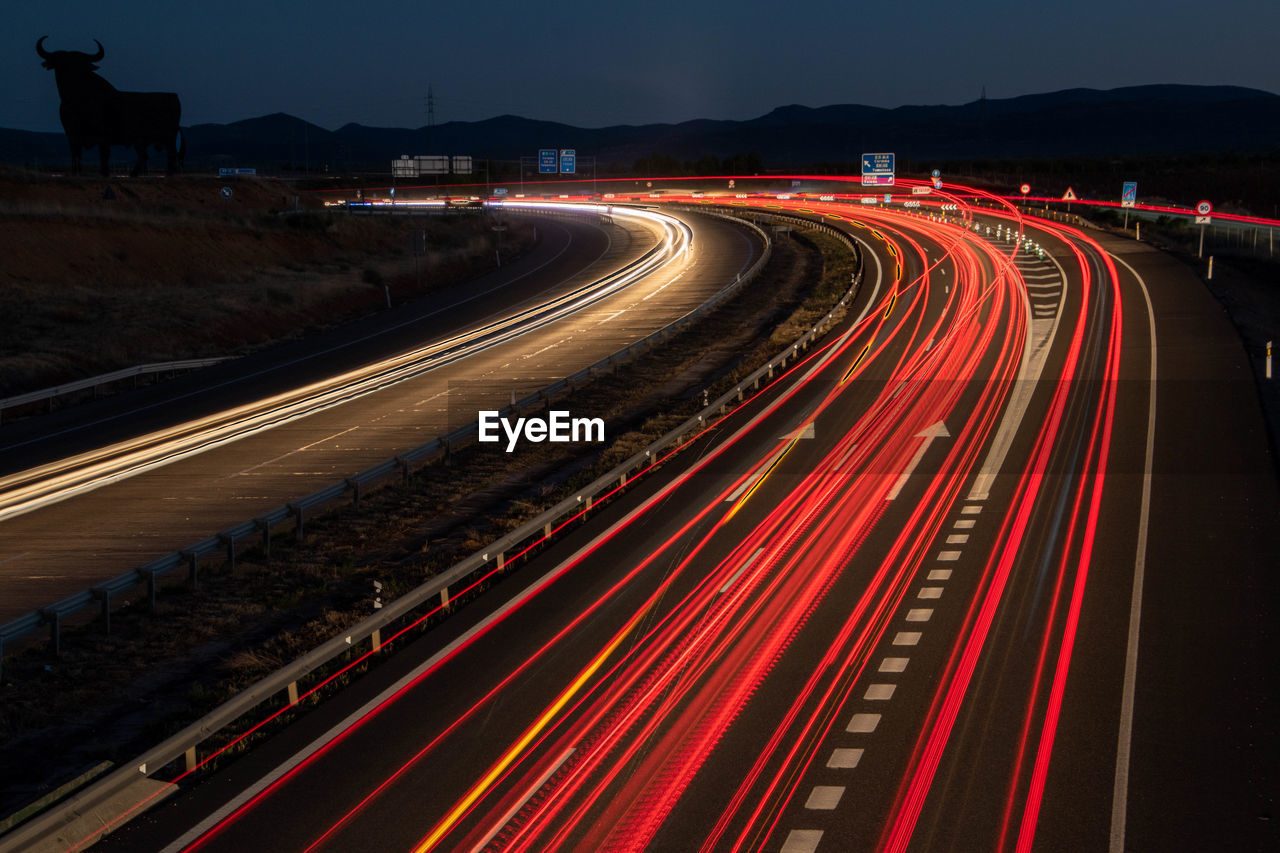 High angle view of light trails on highway at night. la mancha. spain