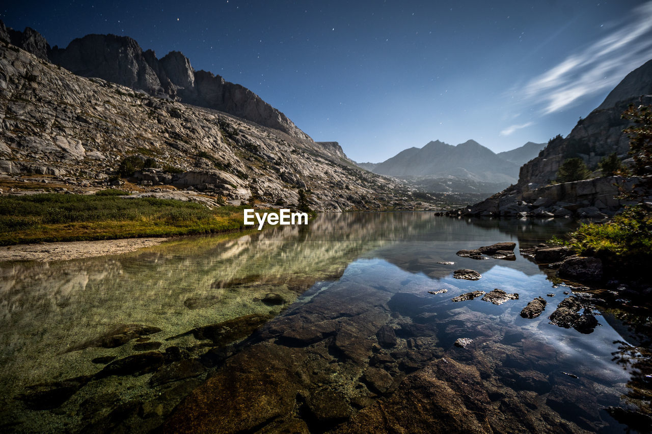 water, mountain, sky, beauty in nature, scenics - nature, tranquil scene, tranquility, rock, nature, lake, solid, rock - object, reflection, mountain range, star - space, night, no people, non-urban scene, idyllic, astronomy, formation