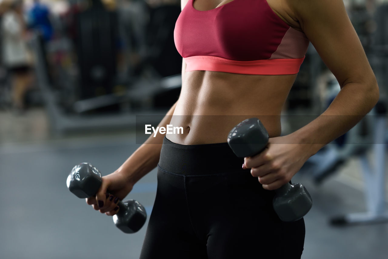Midsection Of Woman Exercising In Gym
