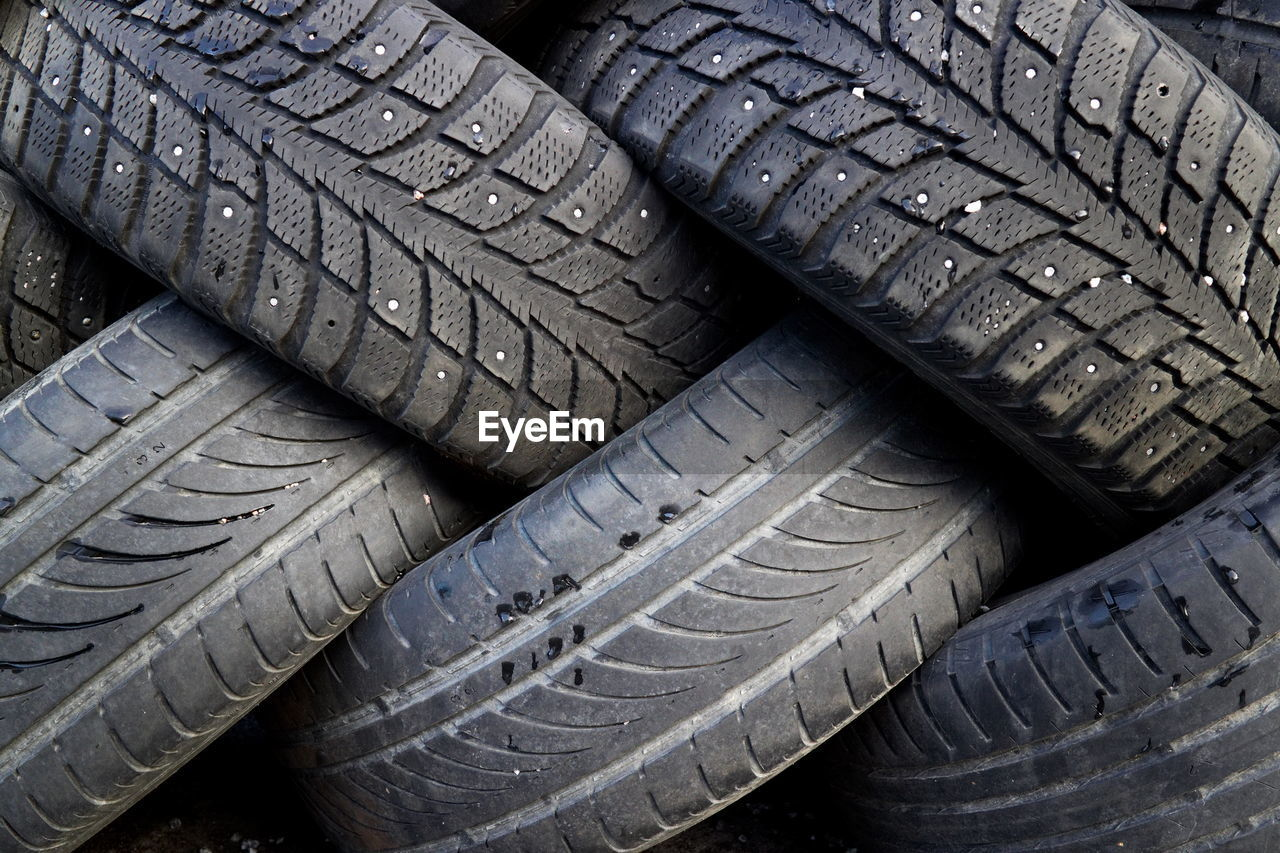 tire, rubber, wheel, transportation, group of objects, full frame, outdoors, no people, sports race, day