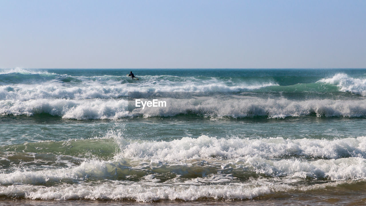 sea, wave, water, horizon over water, sport, horizon, aquatic sport, motion, beauty in nature, surfing, sky, scenics - nature, nature, adventure, clear sky, people, day, extreme sports, power in nature, outdoors