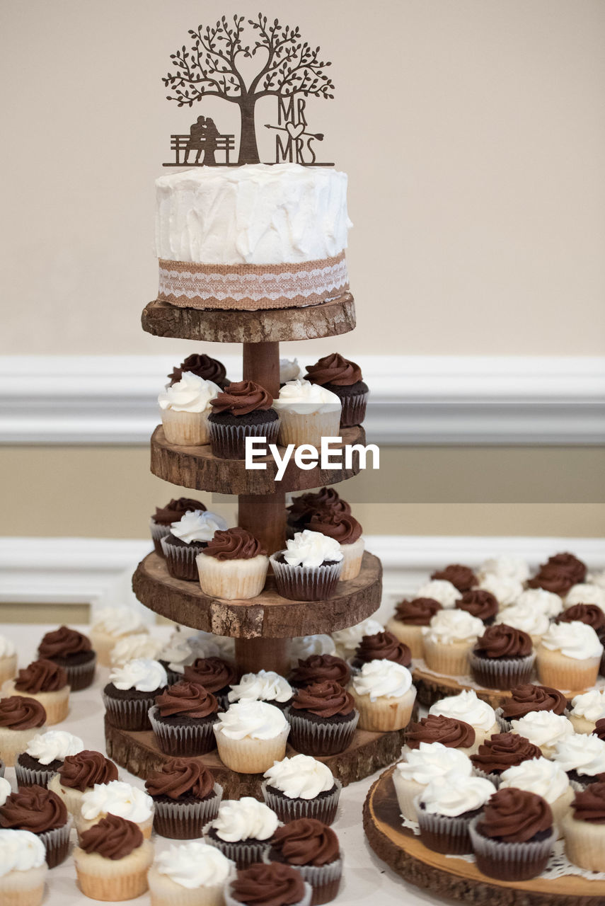 sweet food, cake, sweet, food and drink, dessert, indulgence, food, cupcake, baked, indoors, temptation, freshness, still life, no people, unhealthy eating, ready-to-eat, table, cakestand, choice, large group of objects, wedding cake, cupcake holder