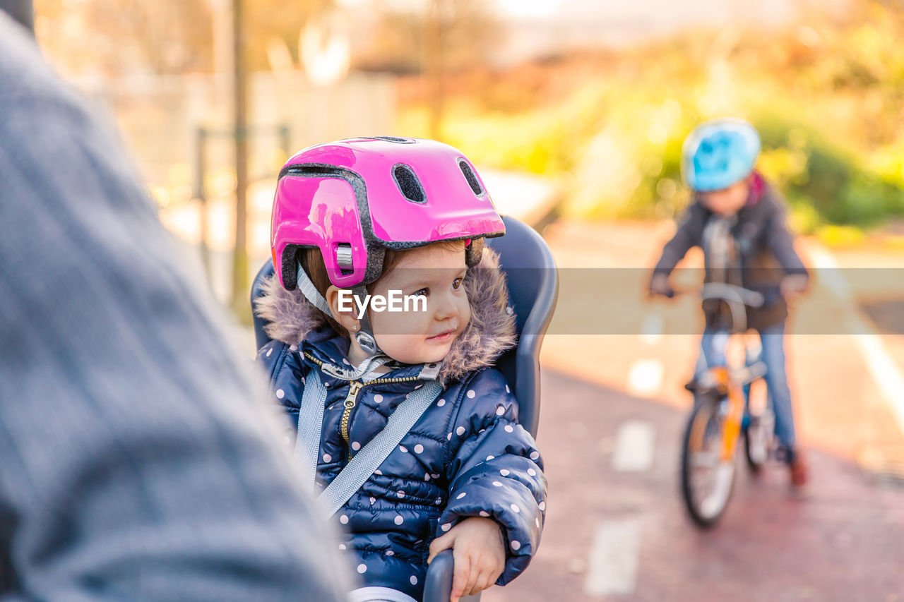 Father Taking Daughter For Bicycle Ride