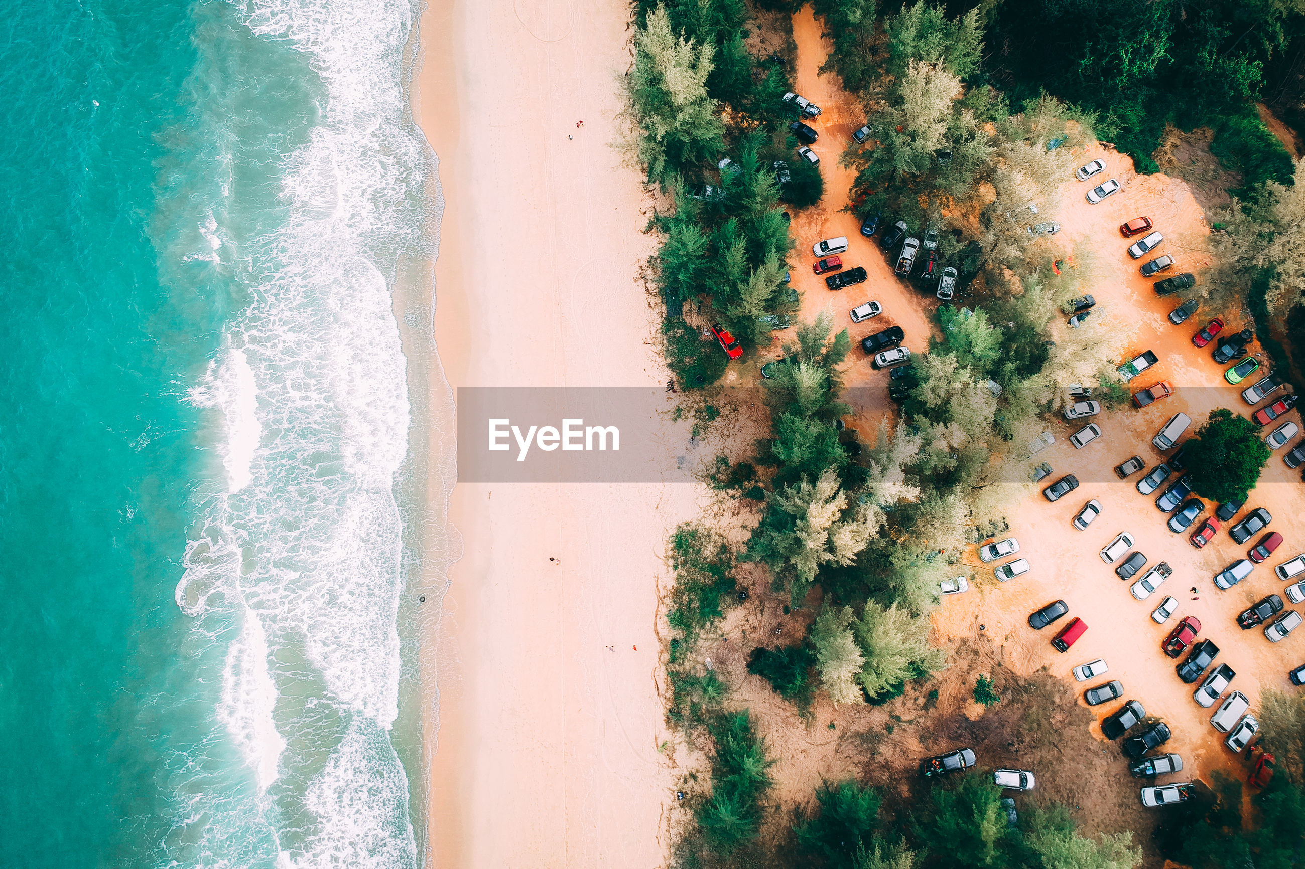 HIGH ANGLE VIEW OF BEACH BY SEA