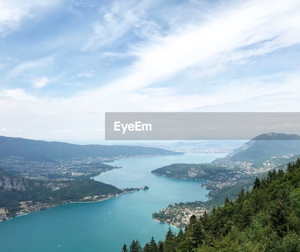 water, mountain, cloud - sky, scenics - nature, sky, beauty in nature, nature, day, tranquil scene, architecture, high angle view, tree, tranquility, no people, plant, mountain range, built structure, sea, building exterior, outdoors, cityscape, bay