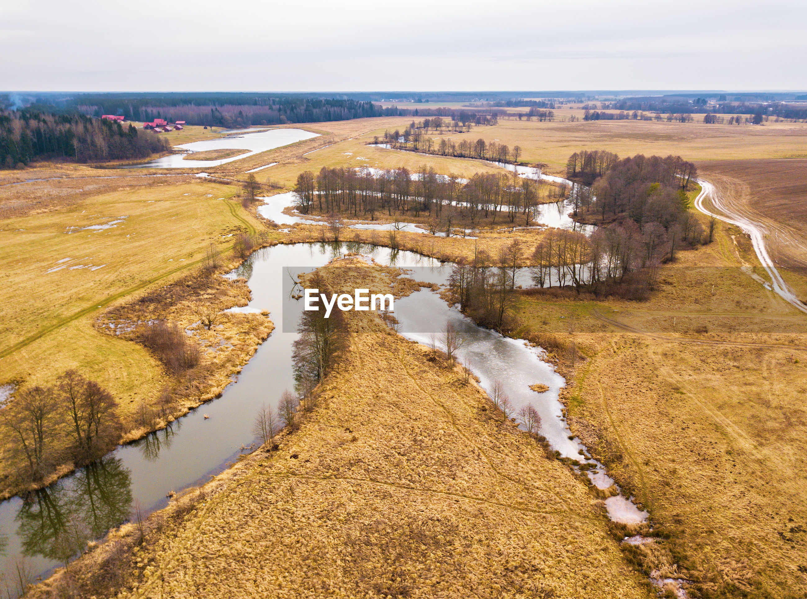 HIGH ANGLE VIEW OF RIVER AMIDST LANDSCAPE